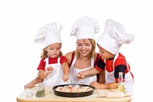 397252-kids-and-their-mother-preparing-a-pizza